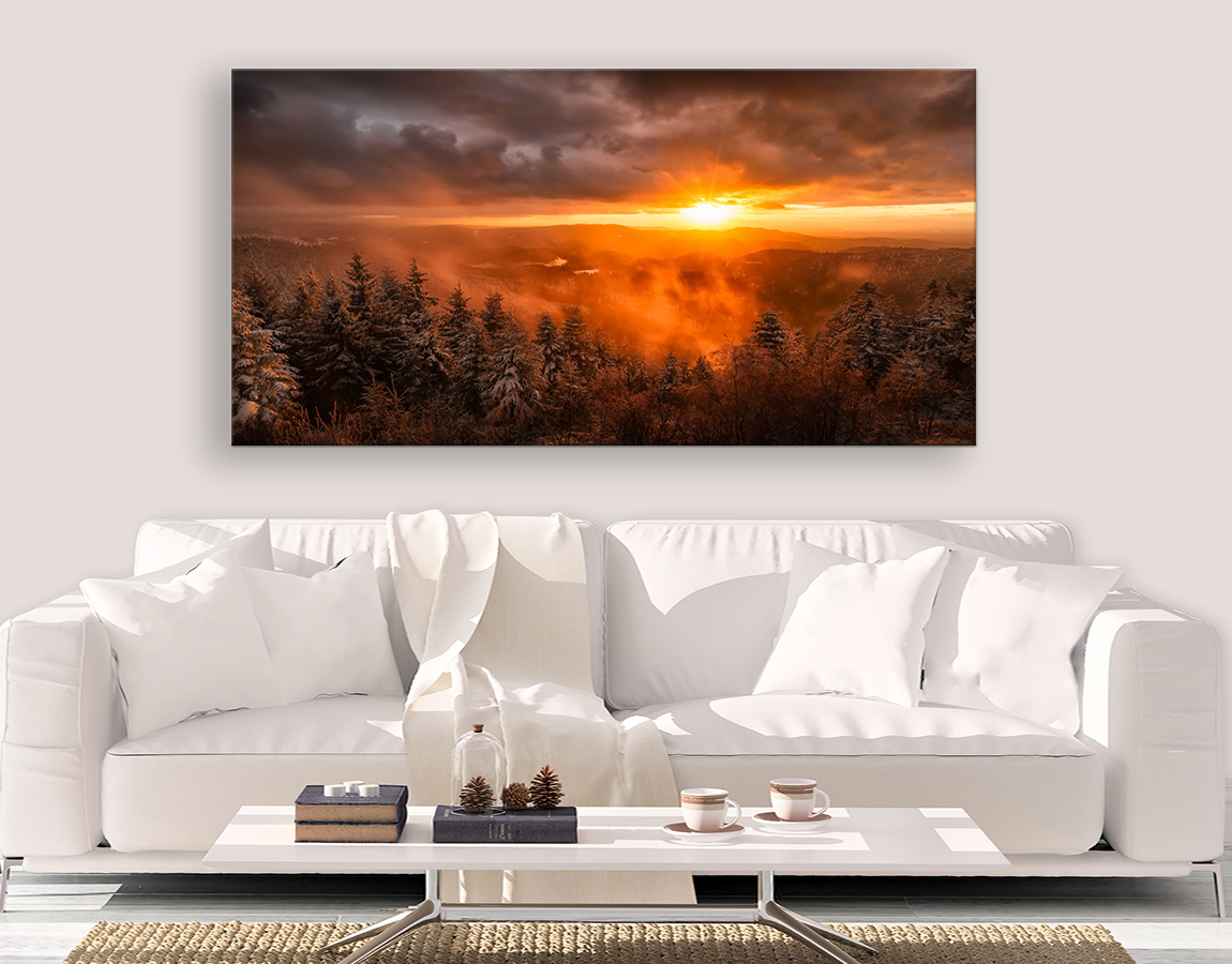 Sunrise over snowy forest